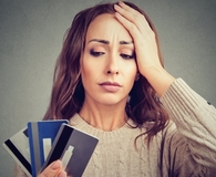Woman carrying credit card debt in 2019