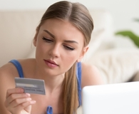 Woman worried about credit card rewards costing her