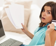 Woman making credit repair mistakes that will cost her