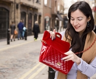 Woman learning things every frugal person should have in their wallet