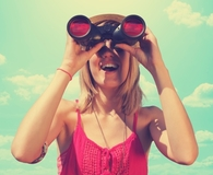 Woman using the best binoculars