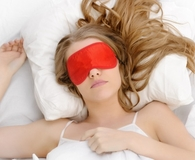 Woman using best eye masks to sleep