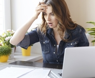 Woman learning ways her savings account is costing her