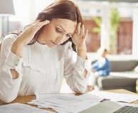 Woman figuring out what to do after loan defaults