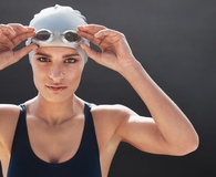 Woman using best swim goggles