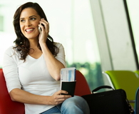 Woman talking on mobile phone at airport