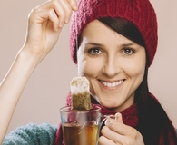 Woman finding clever uses for tea bags and hair clips