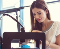 Woman learning ways a 3d printer can save her money