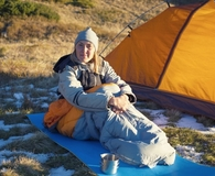 Woman sleeping on best camping sleeping pad