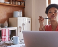 Woman learning how to tell if her 401K is good or bad