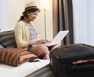 Woman using money saving travel gadgets