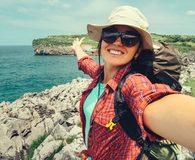 Woman earning travel miles without a credit card