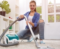 Woman using best bagless vacuum