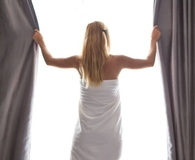 Woman using best blackout curtains