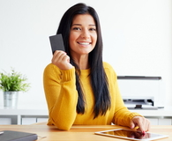 Woman with credit card and tablet computer
