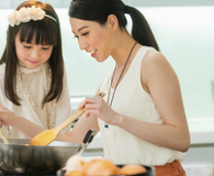 Woman using her electric wok to cook dinner