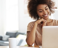 Woman learning ways working from home can cost and save her