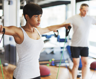 Woman using best resistance bands during workout