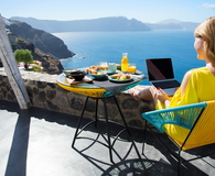 Woman working with laptop while on vacation