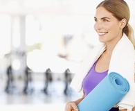 Woman using best hot yoga towels during hot yoga