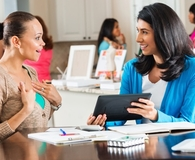 Women learning if a home business is a pyramid scheme