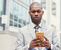 Worried unhappy man talking texting on phone displeased