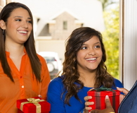 Young adults bring gifts to senior woman