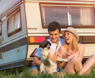 Young couple with a camper van