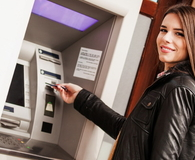 Young woman at the ATM