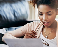 Young woman looking at her financial progress