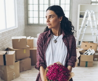 Young woman moving in new home