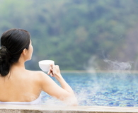 Young woman relaxing in hot springs