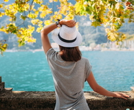 Young woman relaxing on beautiful Garda lake