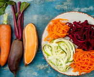 Zucchini, carrot, sweet potato and beetroot noodles on a plate