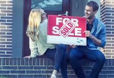 Couple picking the best home offer to sell their house