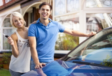 Man and woman with new car