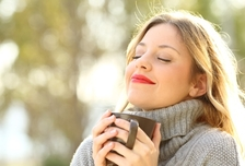 Woman drinking coffee outside for self-care