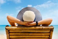 Woman in hat relaxing on beach