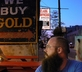 Guy near buying gold sign