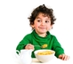 Kid eating corn flakes