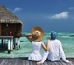 Couple learning to use credit card sign-up spree for a free vacation