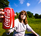 Woman with a can of Coke