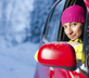 Woman driving safely in winter with new winter tires