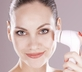 Woman using best facial cleansing brushes for clear skin