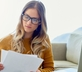 Woman noticing mistakes on her credit report