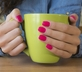 Woman using best manicure kit to paint her nails