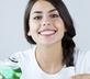 Woman using best mouthwash to keep breath fresh
