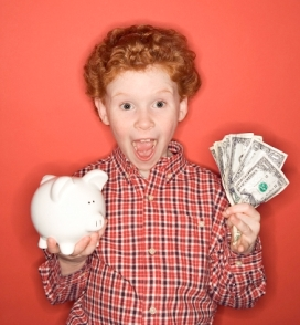 boy with bank and cash