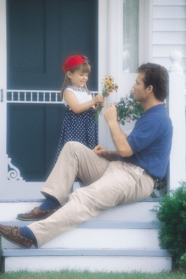 Girl Giving Flower to Dad
